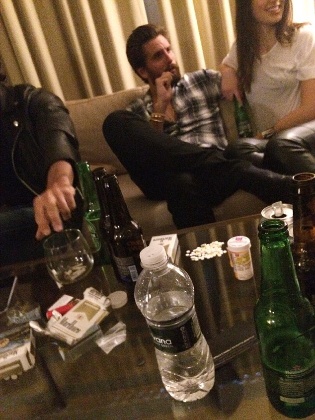 Bender: This photograph, thought to have been taken in mid-June, has surfaced showing Scott in a hotel room sitting close to a mystery brunette while surrounded by booze and prescription drugs