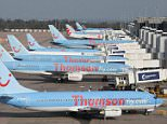 Thomson planes at Manchester Airport.  The eventual disappearance of the Thomson brand will mark the end of a name that has been synonymous with package holidays for a half a century.    PRESS ASSOCIATION Photo. Issue date: Wednesday May 13, 2015. It was in 1965 that Canadian-born media chief Roy Thomson branched out from newspapers to travel by starting Thomson Travel. See PA story CITY TUI History. Photo credit should read: Dave Thompson/PA Wire.  File photo.