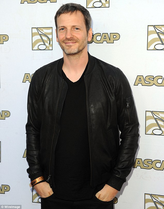 Denies: Dr Luke, pictured in 2013, has said that Kesha made up the claims against him to try and extricate herself from an exclusive recording contract. He has filed a defamation civil suit against her in New York