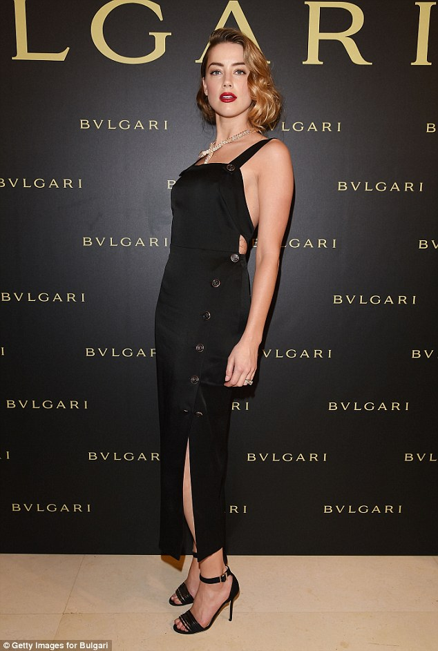 Hollywood star: Amber Heard turned up the glamour as she arrived at theBulgari Haute Couture Cocktail Party & Model Show in Paris on Tuesday, in a stunning buttoned black dress