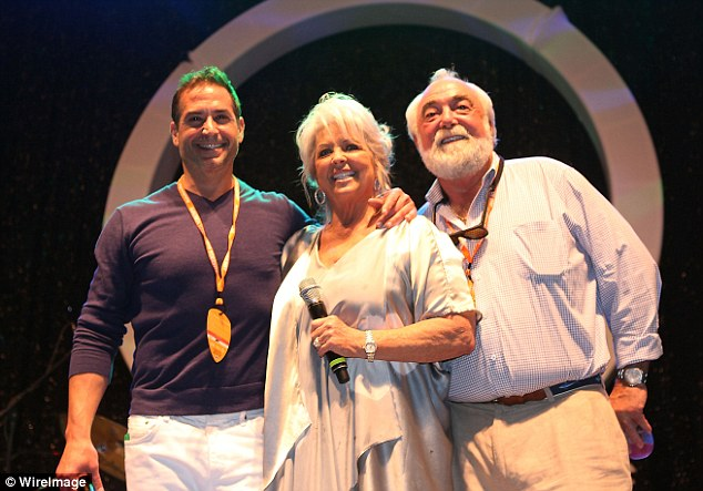 Family: Paula Deen attends a wine and food festival in 2013 with Bobby Deen and her husband, Michael Groove