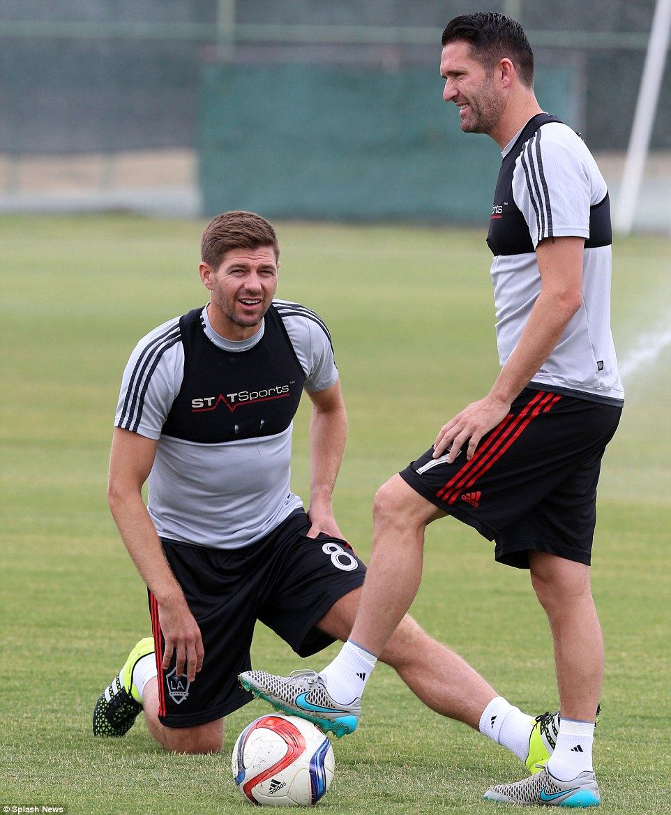 Steven Gerrard chats with former Liverpool team-mate Robbie Keane during his first day of training at new club LA Galaxy