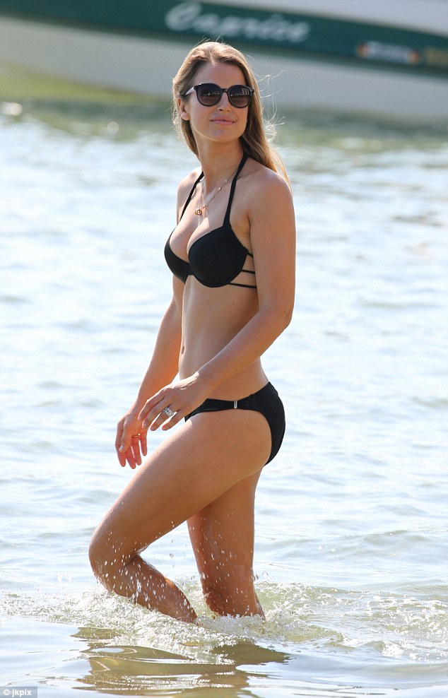 Poolside glamour: The skimpy two-piece with multi strap detail, from Lipsy, made the most of her slender frame and emphasised her tiny waist to perfection as she took a refreshing dip in the water