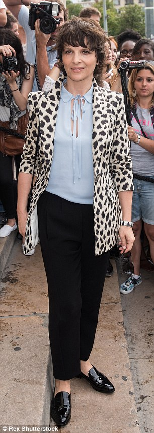 Wild at heart: Actress Juliette Binoche was rocking a youthful leopard print jacket and patent brogues