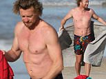 Simon Baker displays a large stomach scar as he goes shirtless at Bondi Beach after a cold swim while his wife watches from the shore all rugged up. Photos taken in Sydney on Thursday 9th July 2015.\\nCarlos Costas.