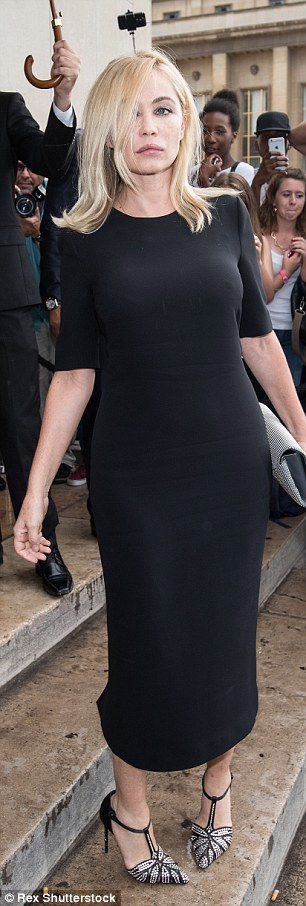 Classic look: Screen siren Emmanuelle Béart donned a chic black dress and metallic heels