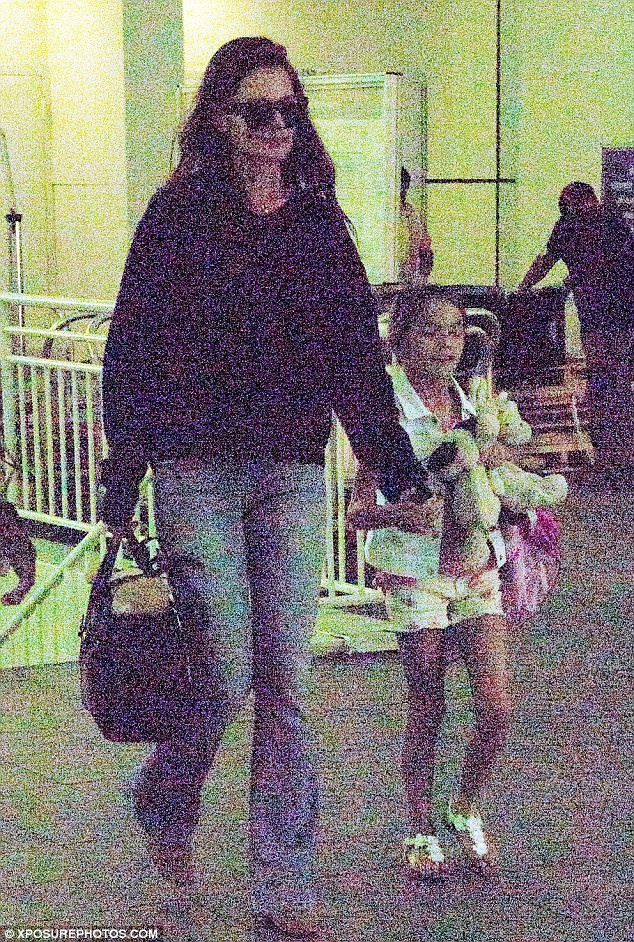 Checking out the new place? The actress was accompanied by her nine-year-old daughter Suri for the trip
