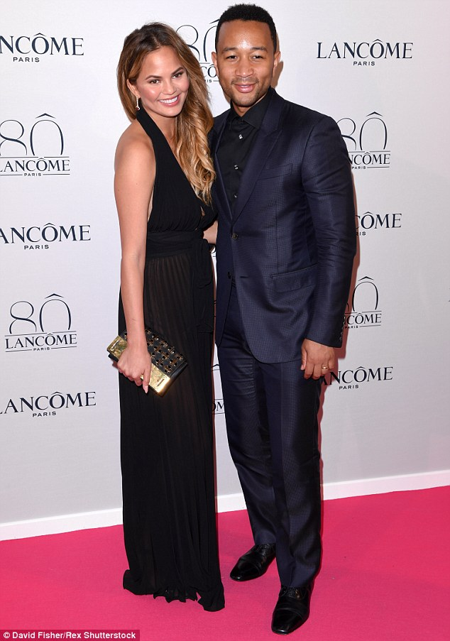 Fashionable couple: Supermodel Chrissy Teigen and her singer husband John Legend looked as loved up as ever on the red carpet on Tuesday