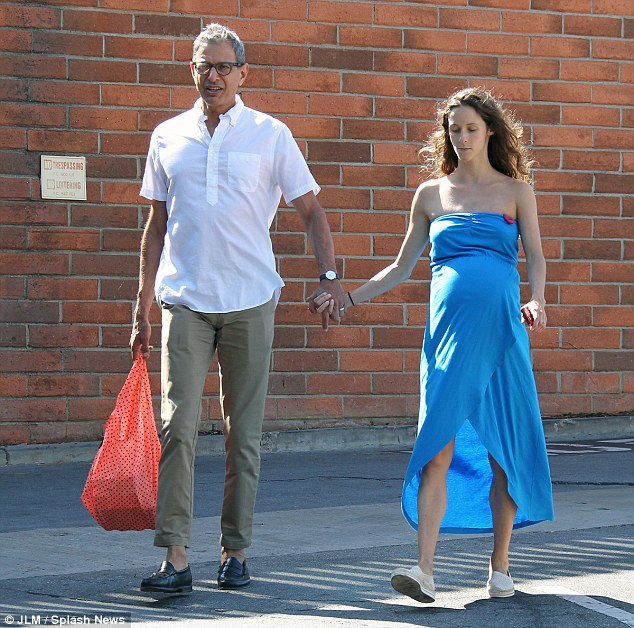 Hand in hand:Jeff announced they were expecting while he was on the Late Show With David Letterman earlier this year. 'She told me the day before we got married that she's pregnant,' Goldblum said; here they are seen in mid June