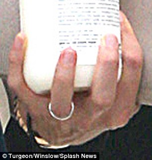 Holding on: The 43-year-old actress appeared to still be wearing her wedding ring