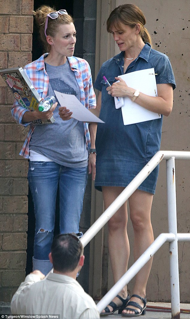 Helping hand: She was spotted meeting up with a female friend as they appeared to go over a document together