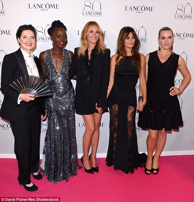 Rocking the red carpet: Holding hands, the five Lancome ambassadors were a quintet of quality styling as they arrived at the soiree, held during Paris' Haute Couture Autumn/Winter 2015 week