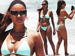Real Housewives of Atlanta star Claudia Jordan, 42, in a teal triangle top bikini at the beach in Miami Beach, Florida.\n\nPictured: Claudia Jordan\nRef: SPL1074466  090715  \nPicture by: Pichichi\n\nSplash News and Pictures\nLos Angeles: 310-821-2666\nNew York: 212-619-2666\nLondon: 870-934-2666\nphotodesk@splashnews.com\n