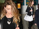 """EXCLUSIVE: Amber Heard returns to Australia after claiming she would """"avoid the land Down Under from now on, just as much as we can"""".\nAmber looked sheepish and bowed her head as she arrived in Brisbane. She will be joining husband Johnny Depp on the Gold Coast, where he is currently filming 'Pirates of the Caribbean: Dead Men Tell No Tales'.\nShe hit out at Australia last month after she and Depp were forced to fly their dogs back to America earlier this year or risk them being euthanized, because the pets flew in on a private jet without documentation.\n\nPictured: Amber Heard\nRef: SPL1060546  090715   EXCLUSIVE\nPicture by: Splash News\n\nSplash News and Pictures\nLos Angeles: 310-821-2666\nNew York: 212-619-2666\nLondon: 870-934-2666\nphotodesk@splashnews.com\n"""