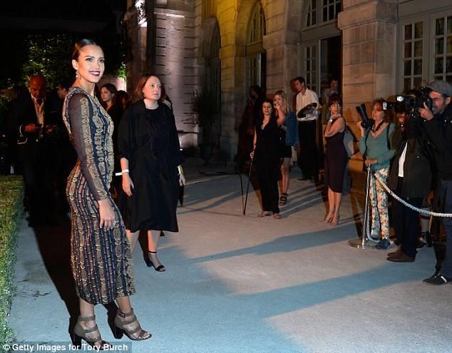 All eyes on her: Jessica was a sight to be behold in front of the army of photographers that awaited