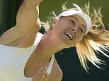 epa04838829 Maria Sharapova of Russia serves to Serena Williams of the US during their semi final match for the Wimbledon Championships at the All England Lawn Tennis Club, in London, Britain, 09 July 2015.  EPA/FACUNDO ARRIZABALAGA EDITORIAL USE ONLY/NO COMMERCIAL SALES