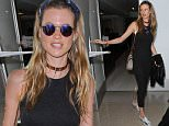 LOS ANGELES, CA - JULY 08: Behati Prinsloo is seen at LAX on July 08, 2015 in Los Angeles, California.  (Photo by GVK/Bauer-Griffin/GC Images)