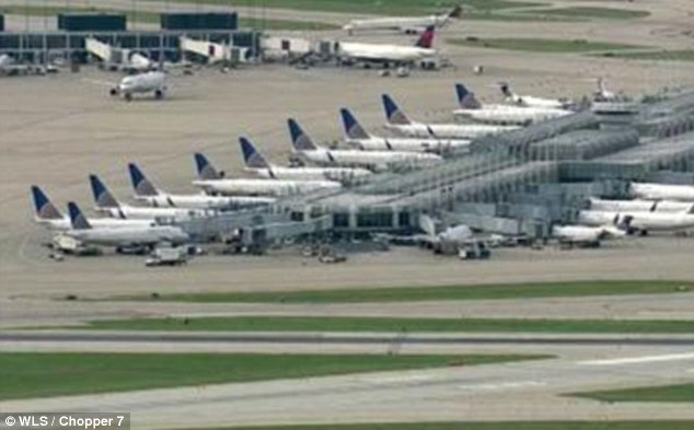 Not going anywhere: Although United did not explain the nature of the issue, passengers said its reservation system was 'down across the board' - meaning those without hard boarding passes could not check in
