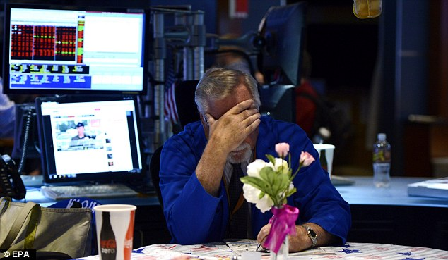 Traders wait anxiously after theNYSE halted all trading, for 'technical reasons' - but says the problem is an internal one and not the result of a cyberattack.