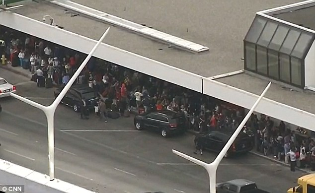 Queue: United passengers are pictured queuing up outside a U.S. airport during the nationwide ground stop