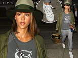 LOS ANGELES, CA - JULY 09: Jessica Alba is seen at LAX on July 09, 2015 in Los Angeles, California.  (Photo by GVK/Bauer-Griffin/GC Images)
