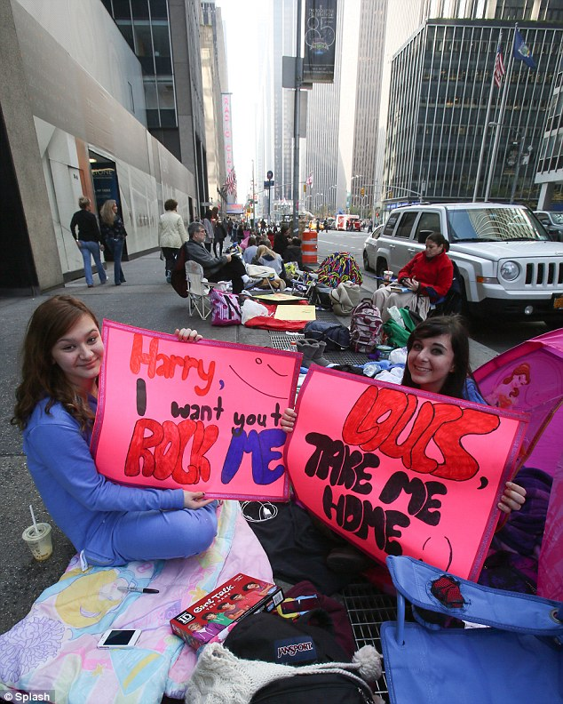 Camped out: One Direction fans have been camped outside Rockefeller Plaza in New York for five days to catch a glimpse of the band who are due to appear on the Today Show on Tuesday