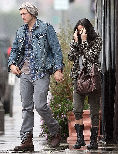 Date day: Ashton Kutcher and Demi Moore looking a bit stressed as they leave Cube Restaurant in Los Angeles, Ca during a very wet and rainy day