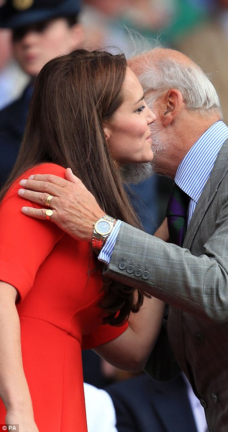 Kate embraces Prince Michael of Kent on centre court during the afternoon of day nine of the championships
