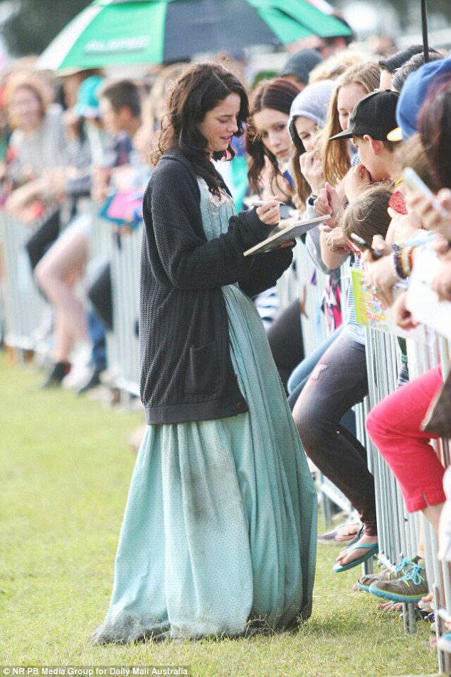 Interaction: The British actress took the time out to stop and sign autographs for her dedicated fans