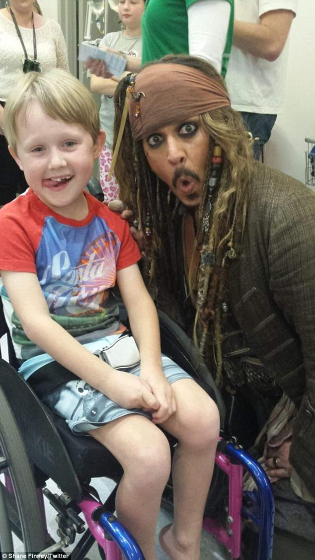 A week of good deeds: On Tuesday Johnny surprised sick children in Brisbane's Children's Hospital with an unofficial visit