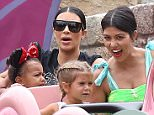 EXCLUSIVE. Coleman-Rayner. Anaheim, CA, USA.  July 08, 2015 Kim Kardashian, daughter North West, along with Kris Jenner and boyfriend Corey Gamble, Kourtney Kardashian and son Mason celebrate Penelope's third birthday at Disneyland. CREDIT LINE MUST READ: Coleman-Rayner Tel US (001) 323 545 7584 - Mobile Tel US (001) 310 474 4343 - Office www.coleman-rayner.com