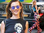 Behati Prinsloo sticks out her tongue, drinks lemonade, and goes produce shopping in NYC\n\nPictured: Behati Prinsloo\nRef: SPL1075010  090715  \nPicture by: XactpiX/Splash\n\nSplash News and Pictures\nLos Angeles: 310-821-2666\nNew York: 212-619-2666\nLondon: 870-934-2666\nphotodesk@splashnews.com\n