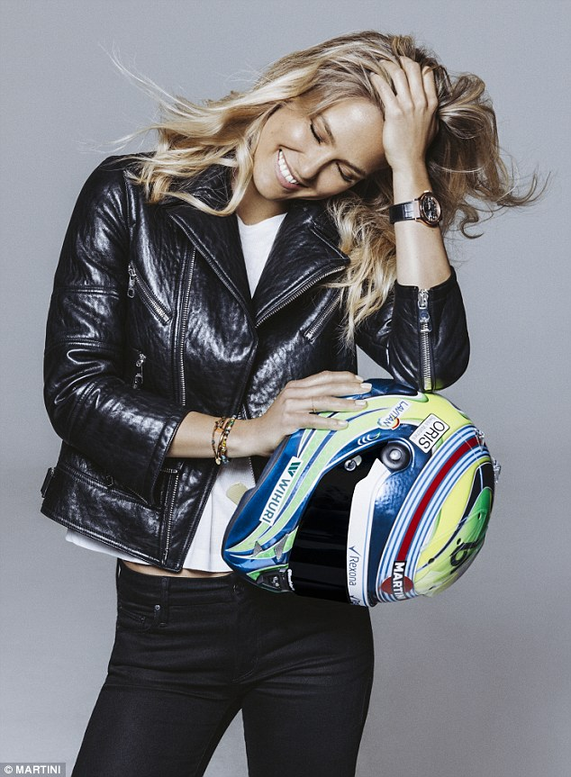 The 30-year-old model, who is an ambassador for Williams Martini Racing, poses in a black Zara leather jacket complete with zip detailing
