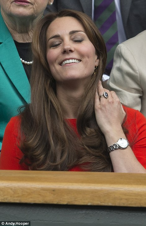 Immaculate: The Duchess of Cambridge looked stunning in her crimson dress and teamed it with a simple silver watch