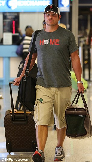 Heavo, ho! Nick and Vanessa Lachey returned to LAX with their son Camden and daughter Brooklyn on Tuesday