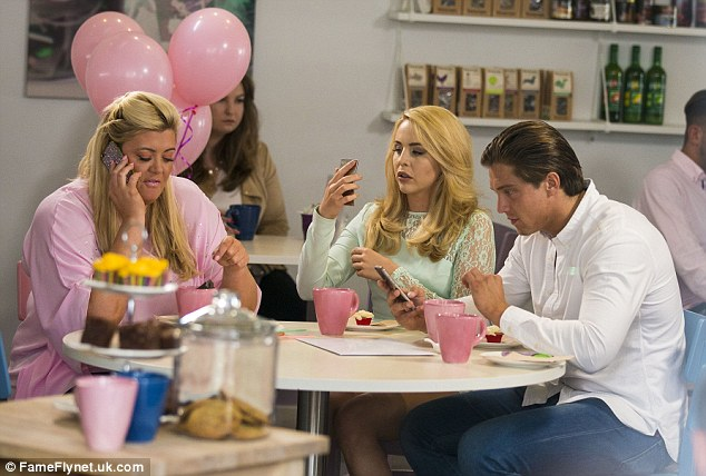 Priorities: Gemma Collins was also in attendance at the tea-party, as she spoke on her diamante encrusted phone while Lydia checked herself out in hers