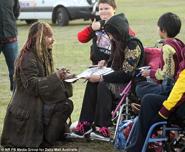 Making their day: The star spent time chatting with fans while signing memorabilia and even a newspaper