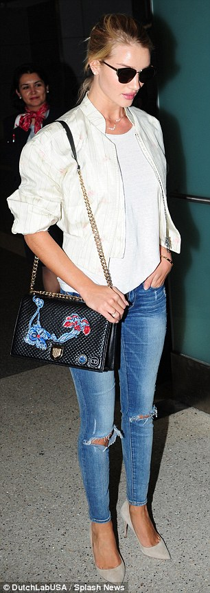 How does she do it?: She had just stepped off a long haul flight from London, but Rosie still looked amazing