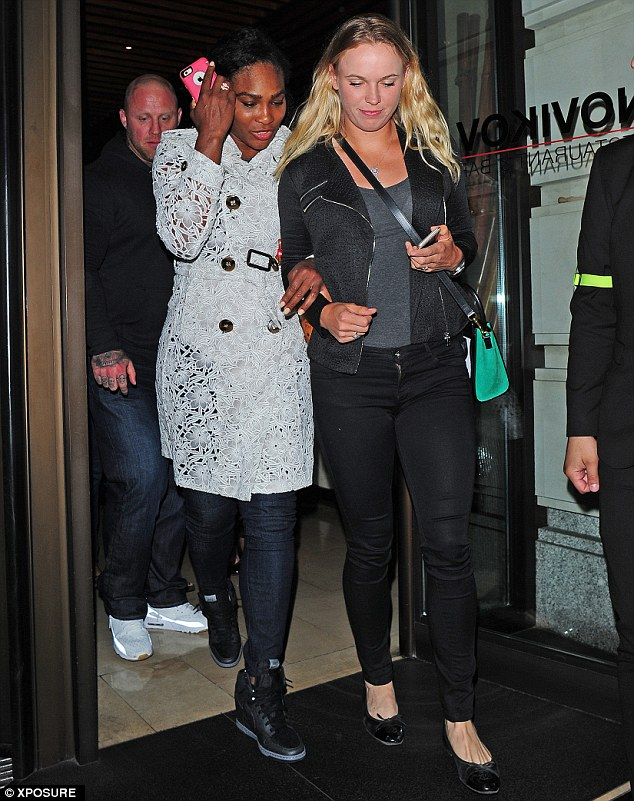 Kicking back: The stars were seen leaving the upmarket Novikov Restaurant, shortly after Wimbledon