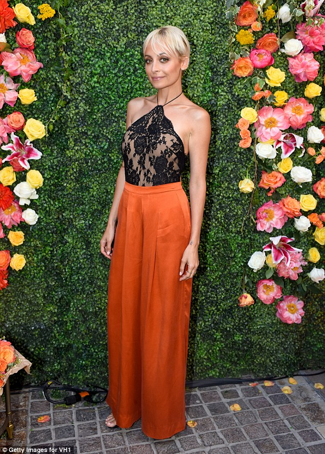 Stunning starlet: Nicole looked lithe in the high-waisted silk trousers and lace top
