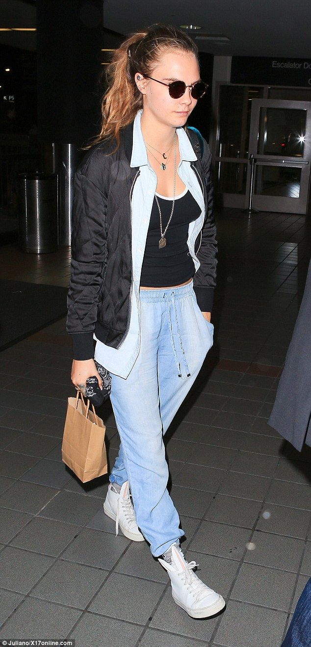 Dressed down: The 22-year-old model rocked double denim as she made her way through the terminal