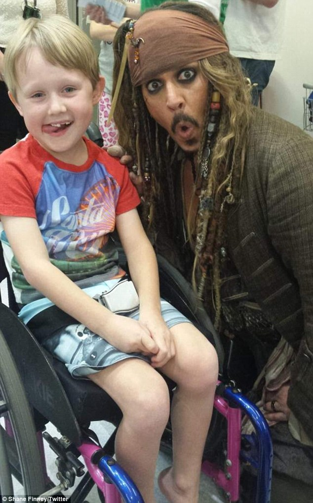 Showing support: Johnny took the time to chat to sick seven-year-oldMax Bennett (pictured) who suffers fromtransverse myelitis
