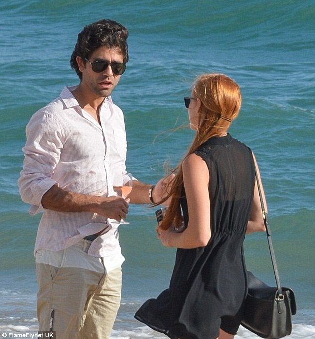 Mr. popular: Entourage star Adrian Grenier was deep in conversation with a mystery redhead on the beach in Cannes last month