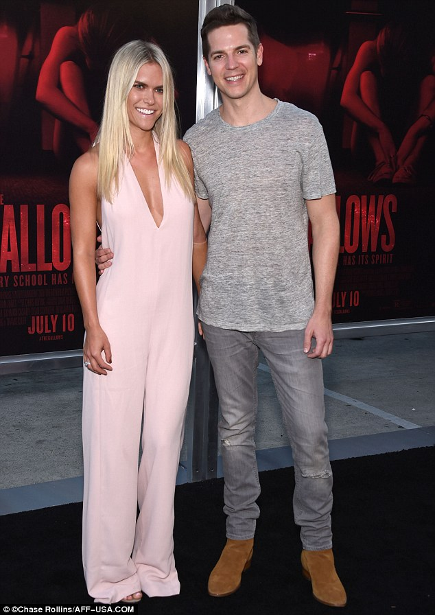 Seventies style: Lauren wore a plunging pink jumpsuit and heels, while Jason dressed down in a T-shirt and jeans