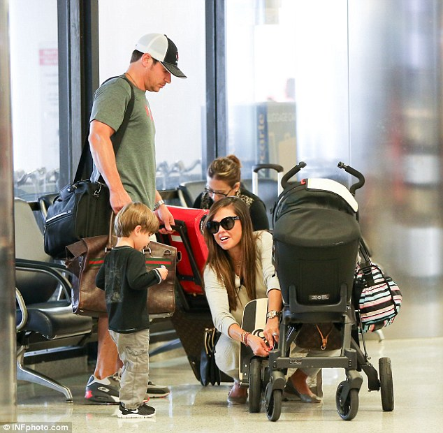 Family matters: Camden watched as his mother fixed her daughter's stroller