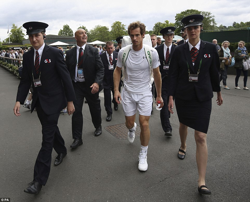 Escort: The British No.1 wasn't short of attention as he strode through the All England Lawn Tennis Club and was flanked by security guards