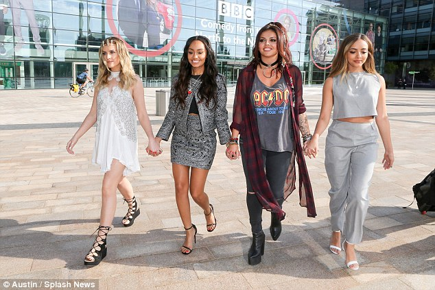 Working hard: Perrie and her Little Mix bandmates were seen arriving at BBC Breakfast studios before their appearance on the show on Monday