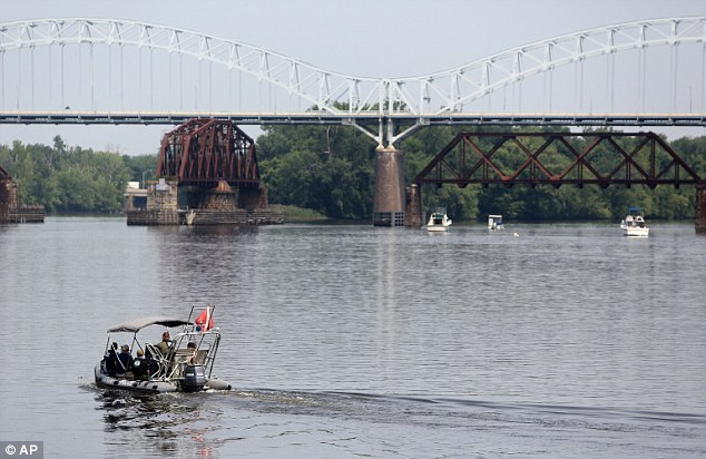 Scene: Moreno's then wrote: 'He's dead', followed by 'And soon I will be too.' Shortly after, the suicidal father apparently leaped from the 90ft bridge (pictured on Monday during the search for Aaden's body)