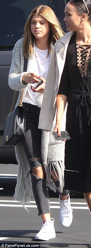 Comfortable: She covered up with a slouchy cardigan