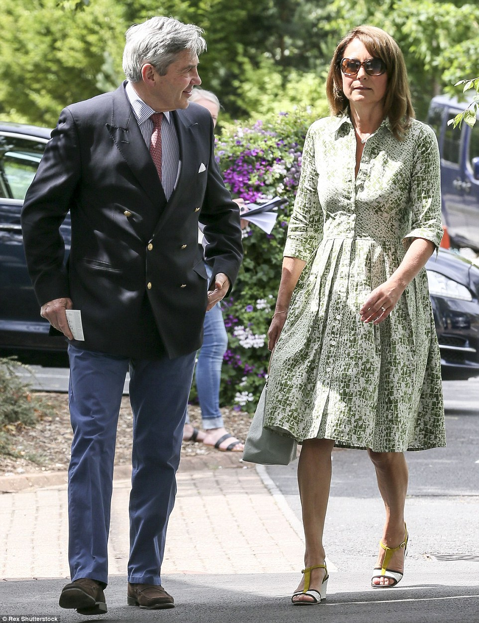 Keeping it in the family: Michael and Carole Middleton made their way into the tournament